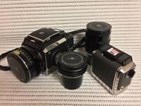 Bronica S2a, 2 film backs, 3 lenses, original strap.