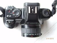 CANON 35MM CAMERA WITH 35MM-80MM TELEPHOTO LENS