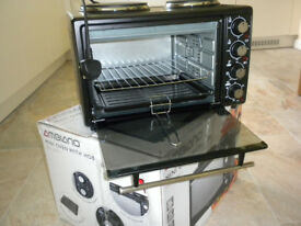 Mini oven with 5 functions with two hob rings & 3 heating ranges which can stand on a table/worktop