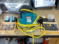 Makita 1\2 inch 1800w router complete with 20 cutting bits