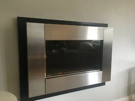 Wall mounted gas fire - clueless, brushed steel and black surround