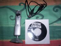 3-in-1 digi camera. Very Good condition with several accessories. As new in box with instructions