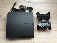 Play Station 3, 2 controllers, dual charger docking station ,games
