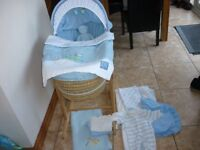 Blue Moses Basket, Rocking Stand, Extra Bedding and Babygrows