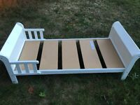 White wooden toddler bed