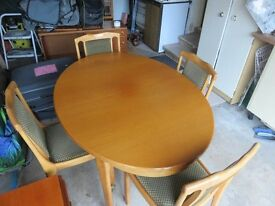 "Dining Table, oval, Teak, 53"" x 39"" (extends to 71 x 39) and 4 Chairs, with soft seats and backs."