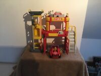 Tonka Fire Station with vehicle and characters.