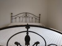 Double bed with matress (135cm). Metal frame