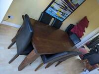 Dark oak wood dining room table and 6 leather chairs £125