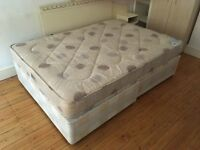 Double bed with headboard and side tables