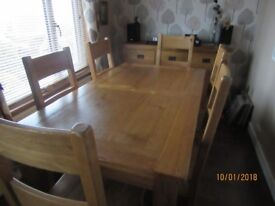Extending Dining Table with 8 chairs.