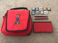 Nintendo 3DS XL red with 9 games