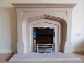 Electric fire and mantle piece surround