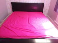 King size Ikea style bed with 2 mattresses