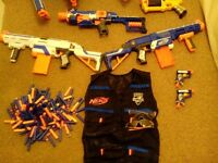Nerf guns of all shapes and sizes with many accessaries
