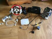 PlayStation One with steering wheel, controllers and games