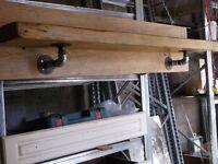 "wood shelf unit with 3/4"" iron brackets and wall plates"