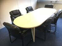 Maple oval boardroom table & 6 quality deep black chairs. Very good condition! High quality