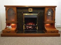 Fire surround. Wood effect fire surround with electric fire. Excellent condition
