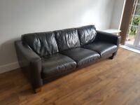 Large three seater brown leather sofa