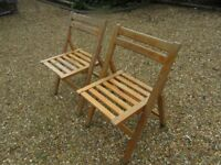 A PAIR OF VINTAGE FOLDING WOODEN CHAIRS. More available , also church pews, benches & pine tables.