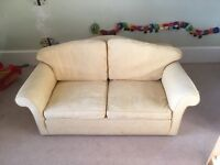 **Yellow, two person sofa**