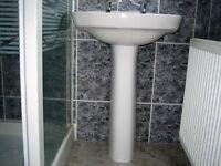 Washand basin and taps