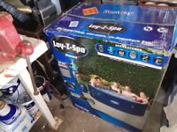 LAY Z SPA MONACO 6-8 PERSON HOT TUB. STILL IN THE BOX. NEVER USED.
