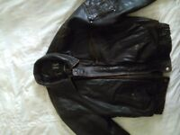 Brown leather jacket ..size M.