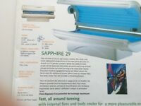 24 Phillips x 100W Cleo tubes + 5 facial. Double canopy white laydown sunbed