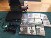 PS3 with box/wires/headset/2 controllers/games