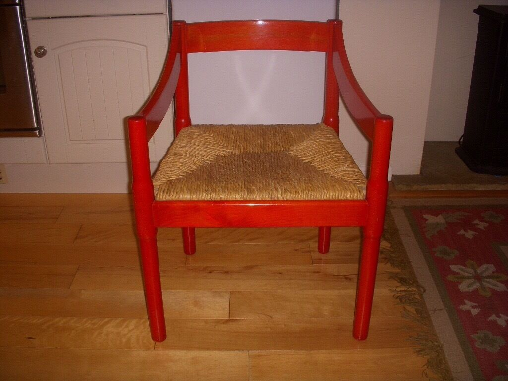 Four 1960s Habitat red lacquered dining chairs, one chair leg needs ...