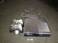 Xbox 360 console, 2 wireless controllers and charging station. 16gb memory stick & 14 games