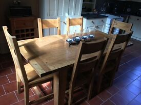 Solid oak extendable dining table and chairs