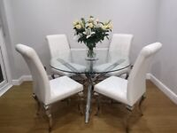 STUNNING CIRCULAR GLASS/CHROME DINING TABLE AND 4 CHAIRS
