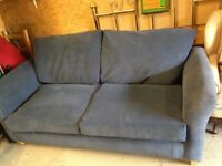 Teal blue sofa