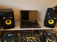 dj decks, mixer and speakers