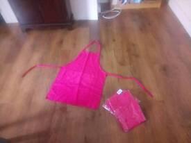 7 bright pink aprons