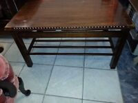 beautiful antique dark brown solid wood coffee table.