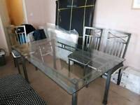Cast iron table with high quality glass top