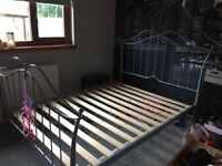 Silver wrought iron double bed