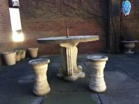 STONE PATIO TABLE AND STOOLS