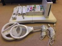 Nintendo wii console and wii fit plus extras