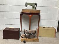 Two vintage sewing machines one Singer