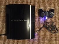 PlayStation 3 Console with 1 Controller & 1 Guitar Hero Guitar