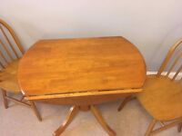 Small Round Drop Leaf wooden pine Table and 2 chairs Good Condition