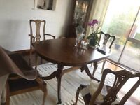 Dark wood dining room table with 6 chairs