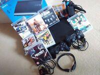 Sony PS3 SuperSlim 120GB bundle, 2 DUALSHOCK controllers, Singstar mics, 8 games