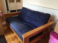Pine futon with navy blue cushion