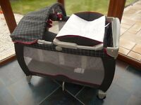 Graco fold up travel cot/basinette with changing mat